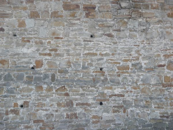 Flat stone wall texture in medieval style with rough  white concrete and  small holes in. flat medieval stone wall 0016   Texturelib