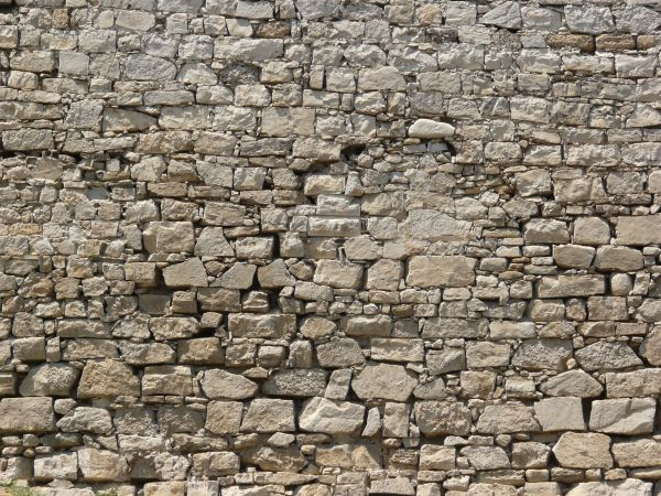 Seamless texture of medieval stone wall consisting of grey stones of  various shapes and sizes. seamless stone wal ltexture 0037   Texturelib