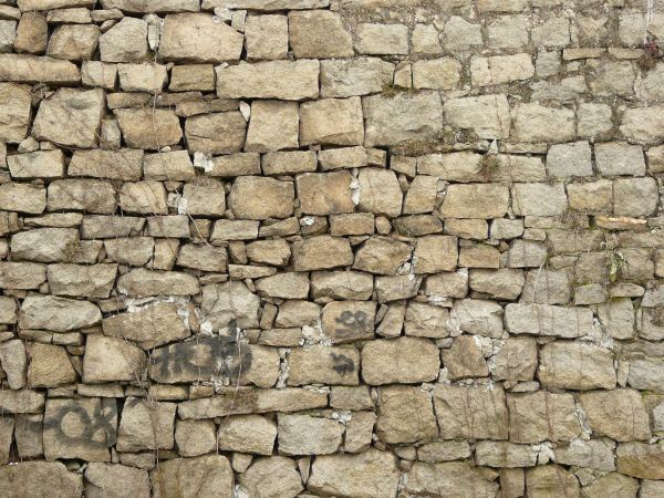 Medieval texture of irregular  stone wall in grey tone with loosely placed  stones of. old wall textures   Texturelib