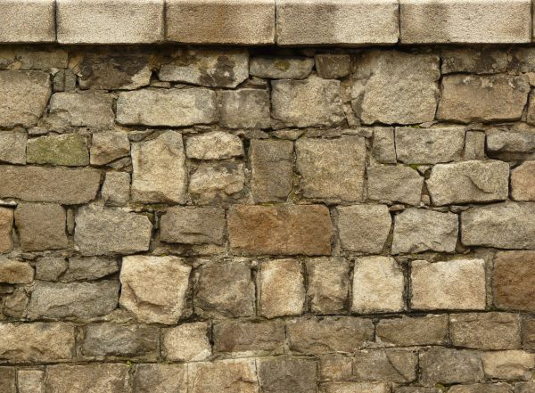 Stone wall texture in medieval style of large stones with small  loose  stones in cracks. old wall textures   Texturelib