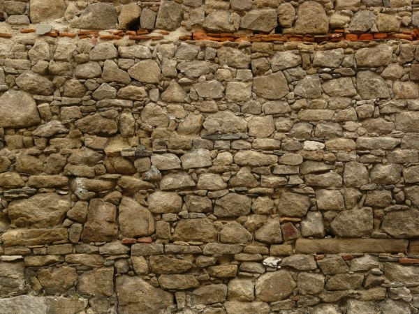 Texture of medieval wall made of stones of various shapes and sizes set  loosely in concrete  loose stone wall. old wall textures   Texturelib