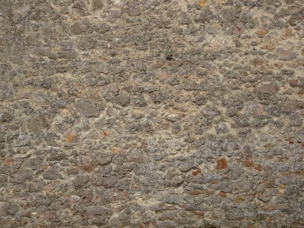 Medival stone wall made of stones of various shapes and sizes in light  brown concrete. medieval stone wall texture 0093   Texturelib