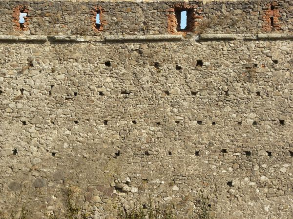 Medieval texture of irregular  stone wall with holes and slightly worn  surface. old wall textures   Texturelib