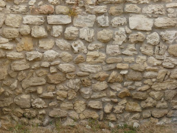 Medieval texture of stones of various sizes set in grey concrete  stone wall. old wall textures   Texturelib