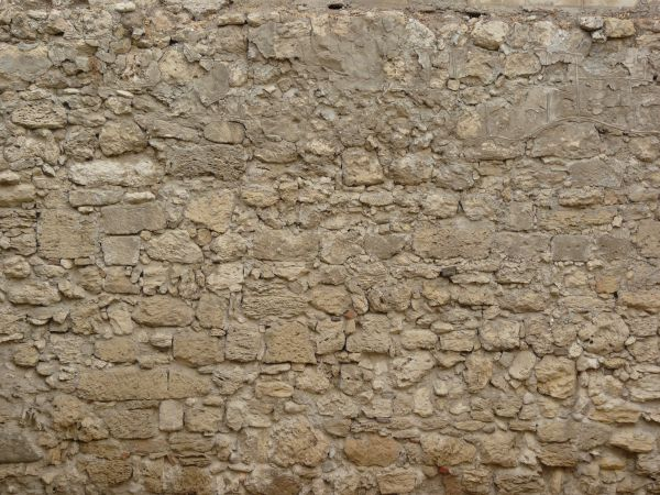 Medieval wall of grey stones set in grey concrete in irregular formation. old wall textures   Texturelib
