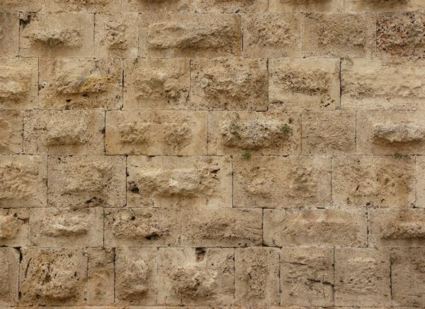 Medieval texture of large  square stones in beige color with rough  worn  texture  rough medieval stone. old wall textures   Texturelib