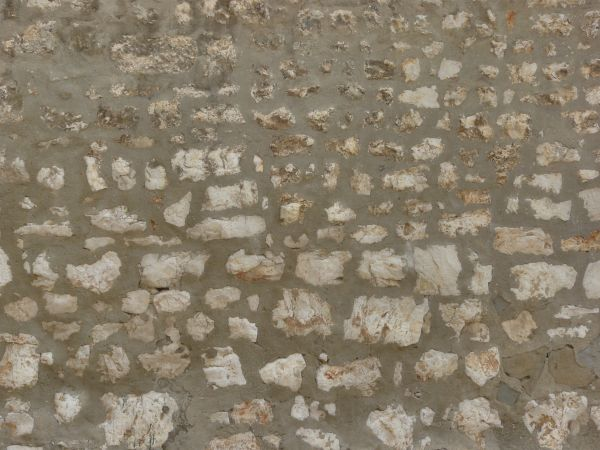 Medieval texture of large stones of various shapes set in dark grey cement. medieval stone texture 0114   Texturelib