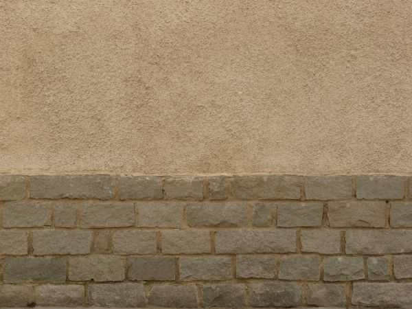Large Grey Brick Texture Formed Into A Short Wall Below Of Textured Tan