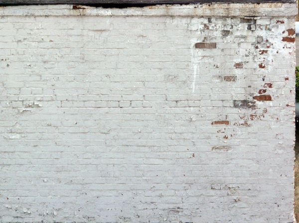 Worn Brick Wall Painted Over In White Tone Paint Is Ling Some Areas