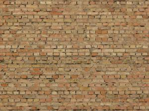 Rustic Brick Wall Of Brown And Beige Bricks With Darks Spots Protruding Grey Cement