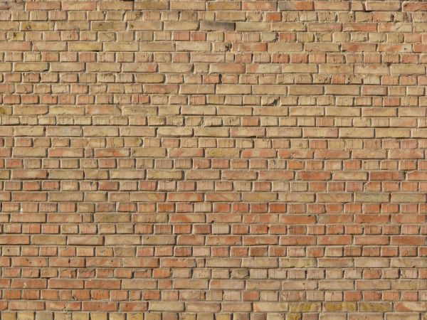 Brick Wall Laid Evenly In Beige Color With Light Brown Set Randomly Throughout