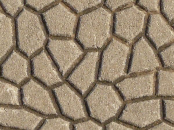 Seamless pavement texture consisting of beige tiles with identical, embedded patterns in surface.
