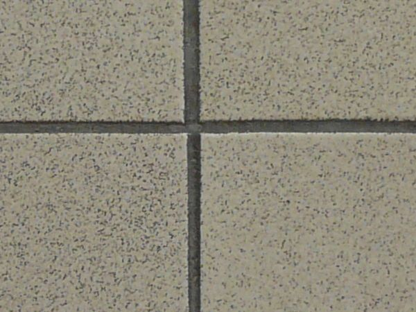 Pavement of square tiles in beige tone set evenly.