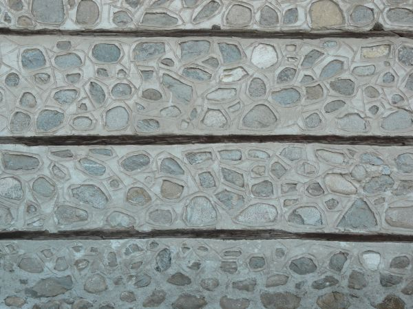 dark stone tile texture. Grey stone covered in light coat of cement  Dark lines divide wall at regular textures Texturelib