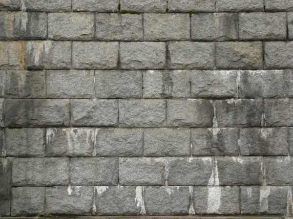 Grey stone set linearly with dark and light water marks. stone wall textures   Texturelib