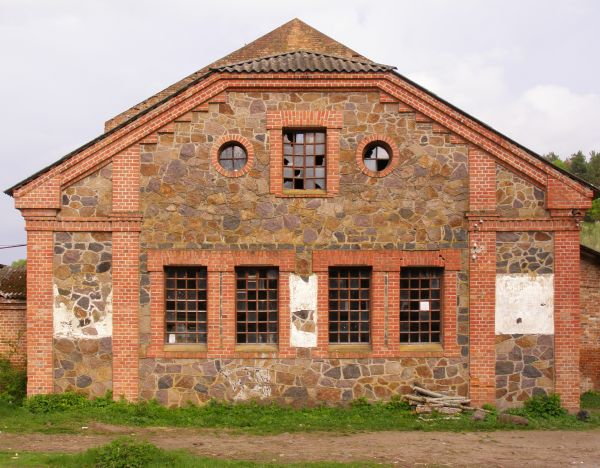 Aged Two Storey Building Made Of Brick And Stone With Broken Windows