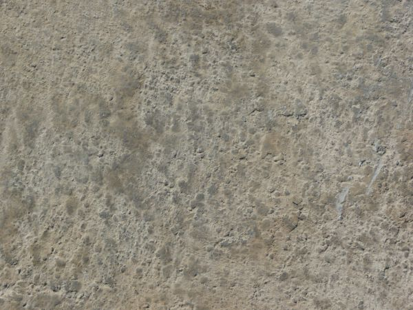 Texture of concrete in grey tones with rough, irregular surface.