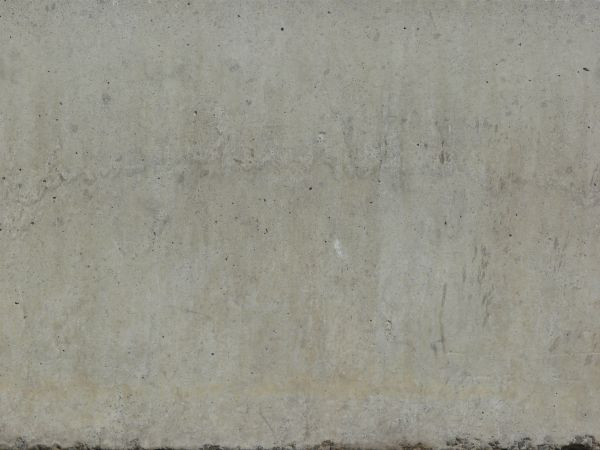 Concrete texture in light grey tone with smooth surface and small holes.