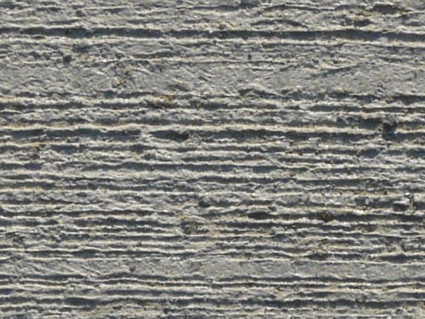 Clean, grey concrete texture with rough consistency and horizontal lines across surface.