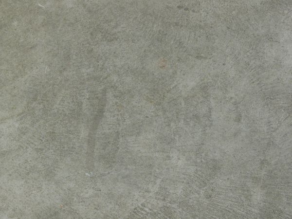Clean concrete texture in light grey tone with lines in circular formations  on surface. clean concrete textures   Texturelib