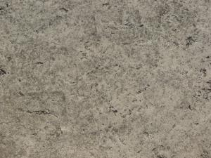 Texture consisting of concrete in light grey tone with very rough, irregular surface.