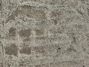 Concrete ground texture in light grey tone with rough surface and dirt.