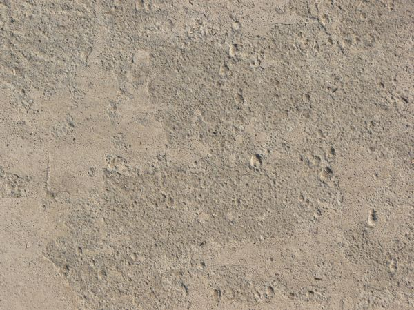 Texture Of Concrete Floor In Light Beige Color With Slightly Rough Flat Surface