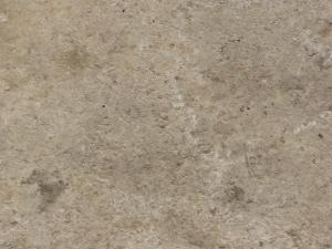 Concrete ground texture in light brown tone with slightly rough, irregular surface.