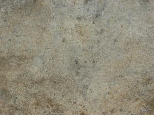 Concrete ground texture in various shades of brown and grey with flat, consistent surface.
