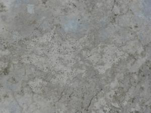 Old concrete floor texture in various tones of grey with few, thin cracks in surface.