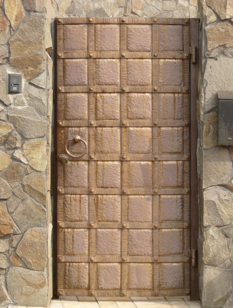 Bronze Door With Grid Like Pattern And Dotted Texture.