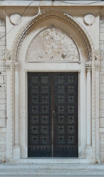 Dark Metal Door With Gothic Design. Doorway Includes Intricate Trims In Dome-like Shape & Gothic Doors Designs \u0026 \