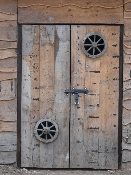Superieur Wooden Doors With Circular Windows And Metal Latch.