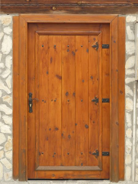 New Old Fashioned Wooden Door In Fresh Lacquer With Iron Hinges And Handle.