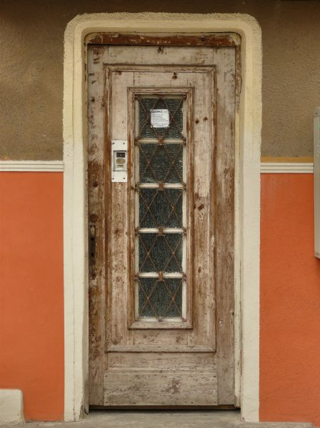 Wonderful Aged Wooden Door With Long Narrow Window Of Patterned Glass.