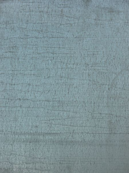 Old Metal Texture In Light Blue Paint With Myriads Of Scratches On Surface