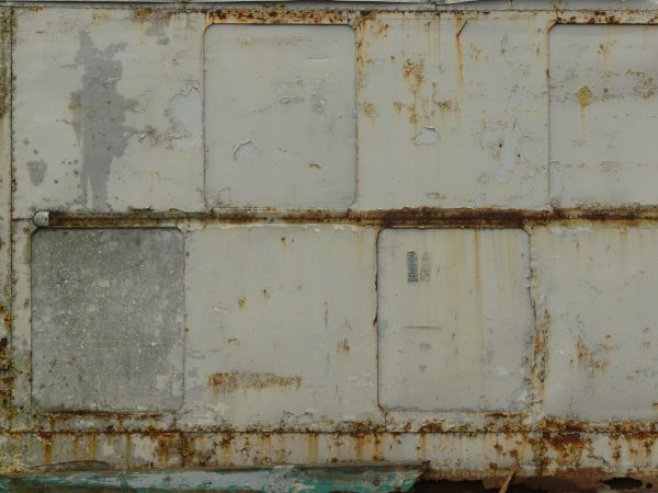 metal texture of panels in off white color with peeling and rusting surface