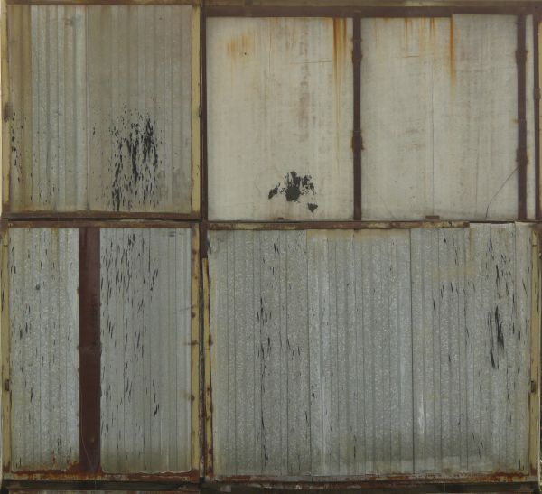large metal panels with damaged rusting surface