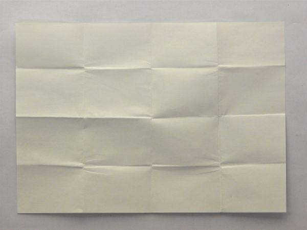 White paper texture with a pattern of rectangular folds covering its surface.