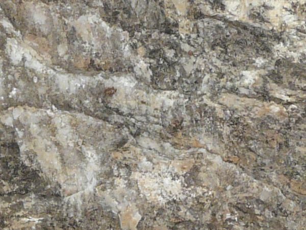 Granite Surface : ... of even, granite rock in brown and grey tones with smooth surface