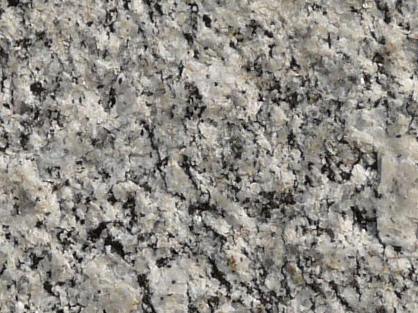 Texture consisting of granite in black and white tones with rough ...