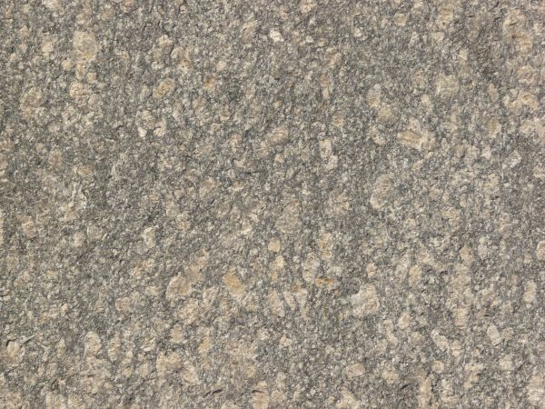 Texture Of Flat Granite In Brown And Grey Tones With Slightly Rough Surface