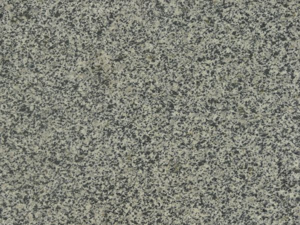 Flat Stone Texture Consisting Of Granite In Light Beige Tone With Black Spots On Surface