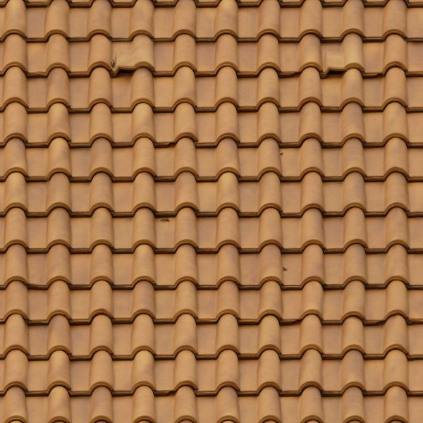 Roofing Made Of New, Light Brown Shingles With Rounded Surfaces.