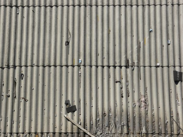 metal roofing texture with trash on wave like surface - Metal Roof Texture