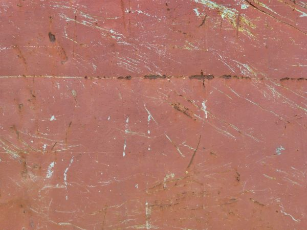 Red Metal Texture Covered With Various Grey And Rusty Brown Scratches Discolored