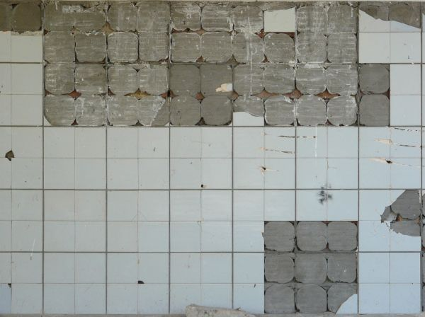 Texture Of Dull White Square Tiles Featuring Small Chips Cracks And Other Markings