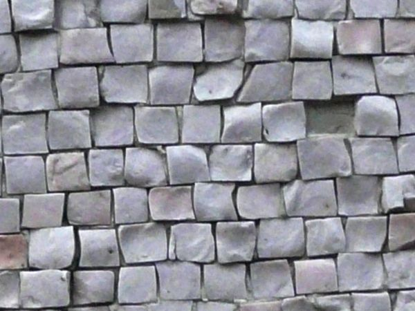 Small, square tiles in shiny, grey color with very rough and uneven ...