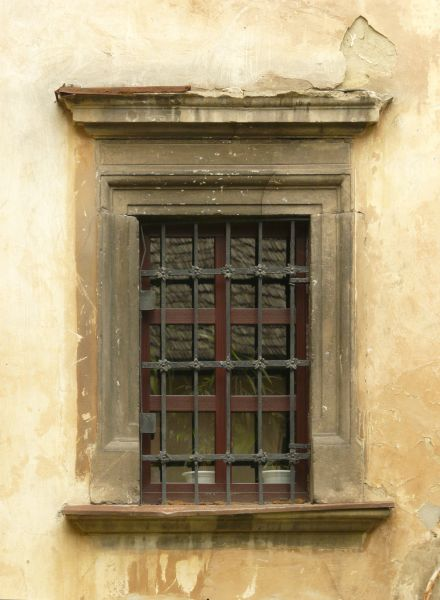 Red window texture with smooth, reflective panes and a frame of
