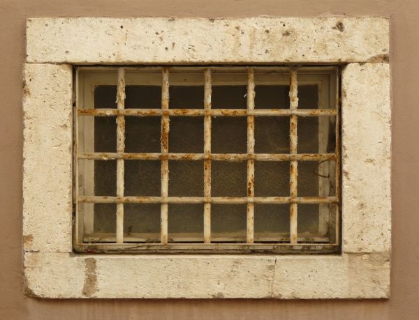 Thick barred window texture, with rusted white paint on the bars and